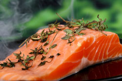 salmon - a good source of protein - mentioned at http://metaboliccookingrevealed.com
